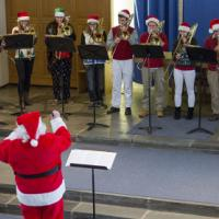 Santa conducts the Trombone Choir at the December 11 Bach's Lunch program