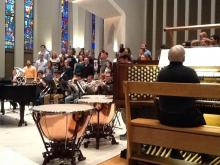 """Rehearsing Vaughan Williams """"O Clap Your Hands"""" with Concert Choir, brass of Symphonic Wind Ensemble, and organist William Neil"""