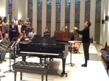 Christopher Kiver conducting a rehearsal