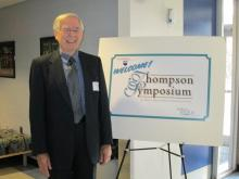 image of Dr. Thompson by Symposium sign