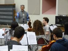 Professor James Lyon works with the violin section
