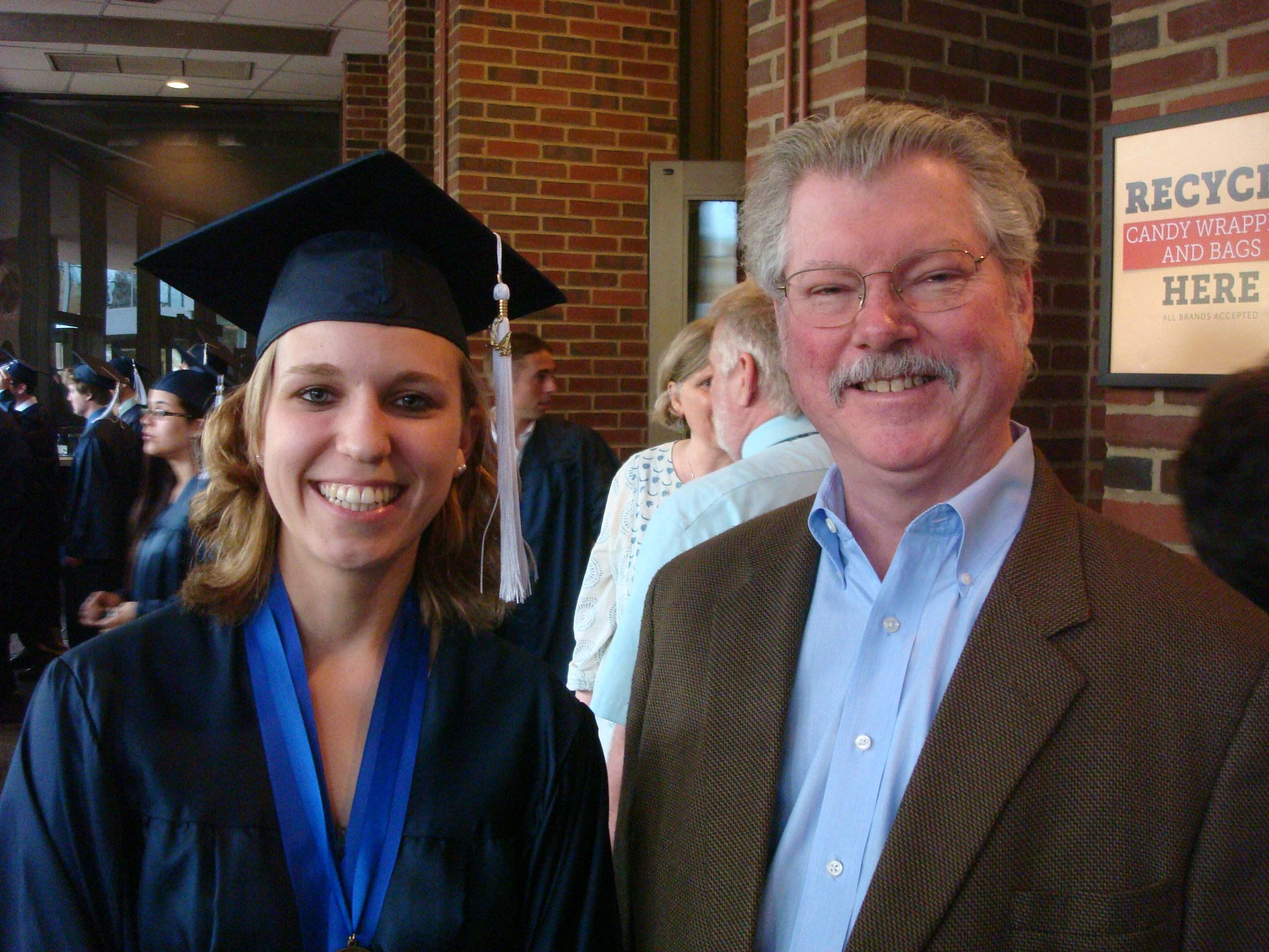Laura Brown at graduation with percussion professor Dan Armstrong