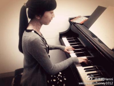 girl playing the piano in a practice room