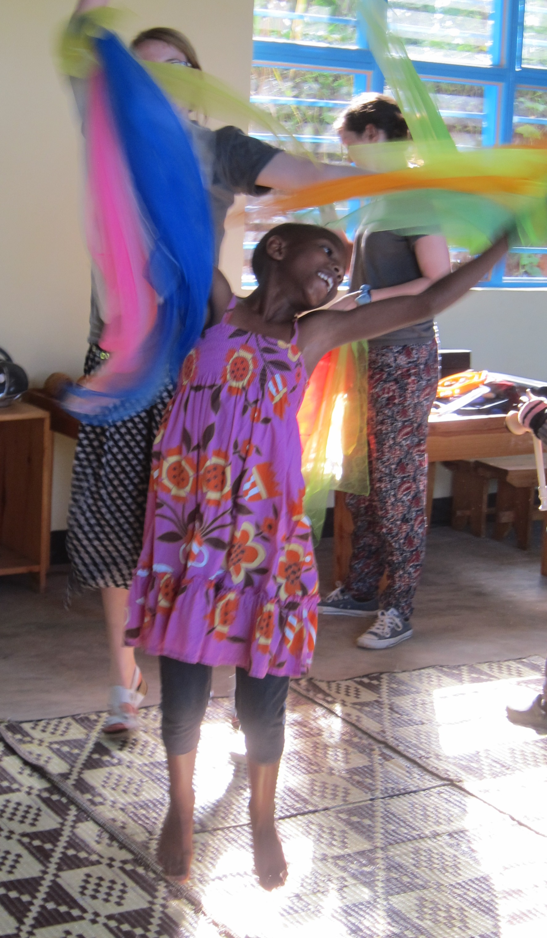 Rwanda child dancing with scarf
