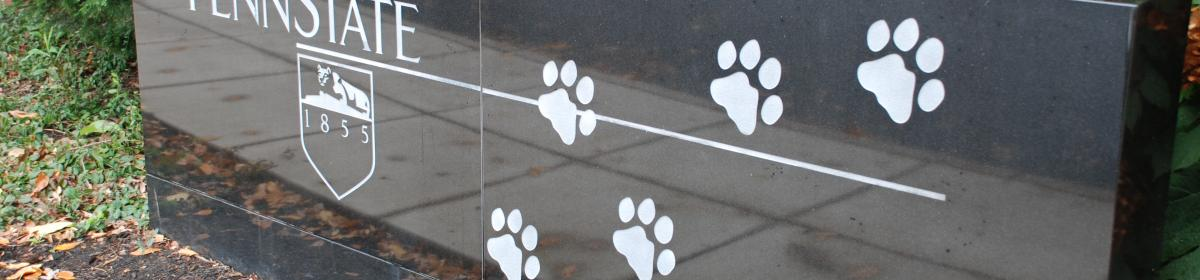 stone PSU sign with lions paws