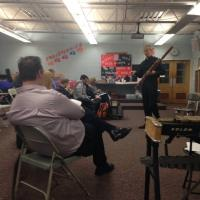 Daryl Durran speaks with band directors at PMEA District 6 festival in Meyersdale, PA