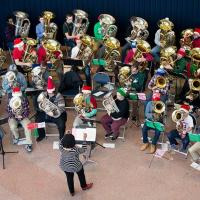 "Professor Velvet Brown conducts at 2014 ""Tuba Christmas,"" a community event featuring 40 tuba and euphonium players, age 11-78."