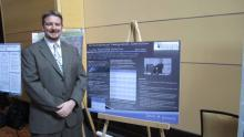 Jason Gossett presents a poster at PMEA Conference