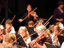 Gretchen assisting with the Penn State/State College 5th Grade Collaboration Orchestra
