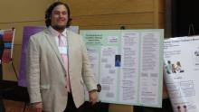 Dan Shevock presents a poster at the PMEA Conference