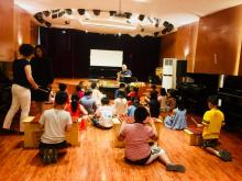 James Eldreth, music education Ph.D. student leading workshop in China