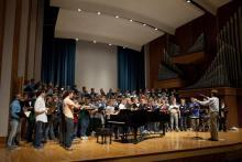 Massed choir on Esber Recital Hall stage