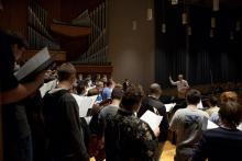 Christopher Kiver works with the Men of Song 2013 choir