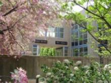 music building with spring blooms