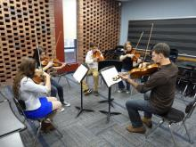 Timothy Deighton works with violists