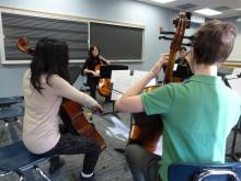 Kim Cook plays with high school cellists