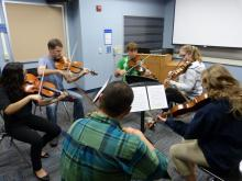 Professor Tim Deighton instructs violists