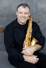 David B. Stambler with a saxophone